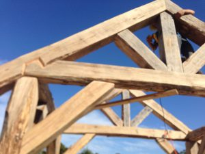 Timber trusses being lifted into place