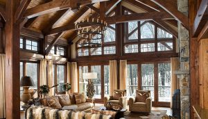 Photo of living room featuring timber beams and trusses
