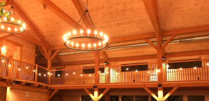 Photo of Timber Frame Structure with wrought iron chandelier