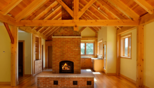 Interior timber trusses with a brick fireplace
